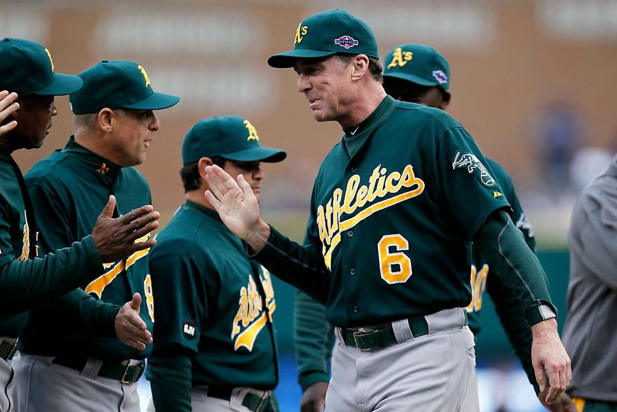 DETROIT, MI - OCTOBER 06: Manager Bob Melvin of the Oakland Athletics greets his players durng introductions against the Detroit Tigers during Game One of the American League Divisional Series at Comerica Park on October 6, 2012 in Detroit, Michigan. (Photo by Gregory Shamus/Getty Images)