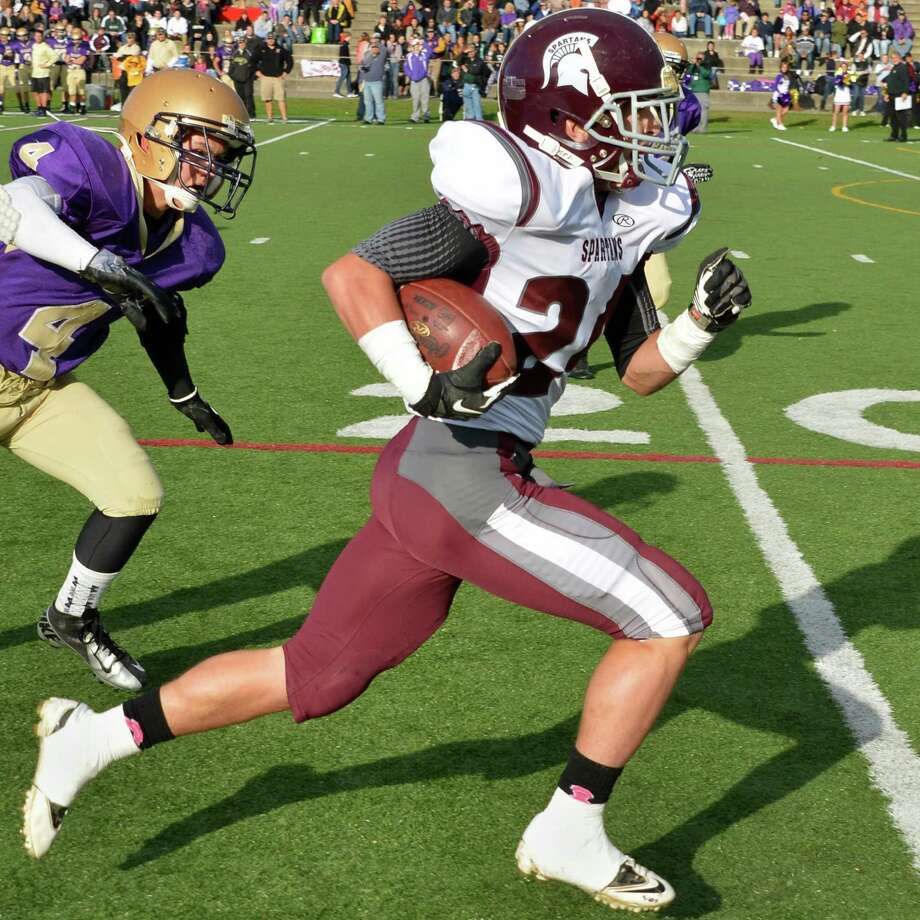 Burnt Hills' #24Josh Quesada runs back an Amsterdam punt Saturday Oct. 6, 2012.  (John Carl D'Annibale / Times Union) Photo: John Carl D'Annibale / 00019496A