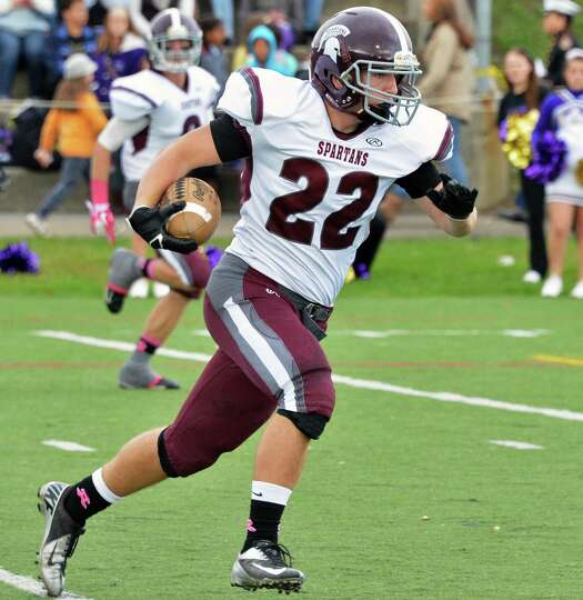 Burnt Hills' #22 Dan Nuzzi steches out a pass completion against Amsterdam High Saturday Oct. 6, 201