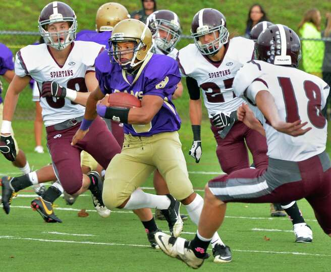 Amsterdam High's #8 Geovanni Rodriguez carries the ball during Saturday's game against Burnt Hills