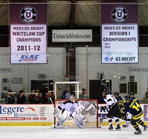 New banners honoring last year's Frozen Four team hang over the Union goal during their season against opener against Merrimack at Union's Messa Rink in Schenectady Saturday Oct. 6, 2012.  (John Carl D'Annibale / Times Union) Photo: John Carl D'Annibale / 00019505A