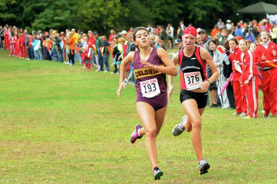 Colonie's Kaitie Schillaci (193), left, and Guilderland's Jenna Robinson (376), right, run stride-for-stride to the finish line in the Division I Girls Grout Run on Saturday, Oct. 6, 2012, at Central Park in Schenectady, N.Y. Robinson crosses the line first to place thirteenth. (Cindy Schultz / Times Union) Photo: Cindy Schultz / 00019470A