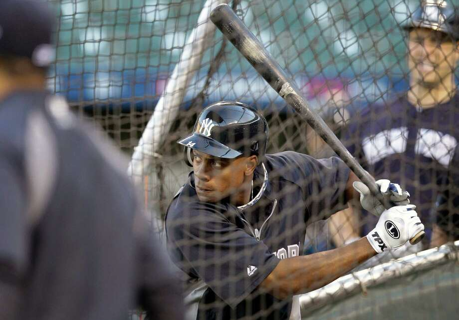 New York Yankees' Curtis Granderson takes part in baseball practice on Saturday, Oct. 6, 2012, in Baltimore. The Yankees and the Baltimore Orioles are scheduled to play Game 1 in the American League division series on Sunday. (AP Photo/Patrick Semansky) Photo: Patrick Semansky