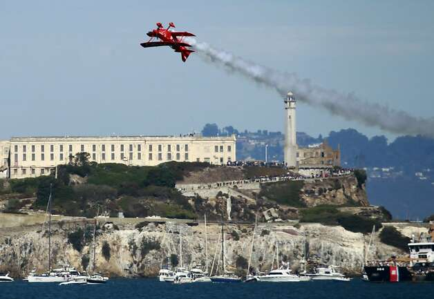 The Oracle aerobatics stunt plane performs near Alcatraz. Photo: Paul Chinn, The Chronicle