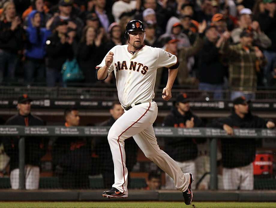 San Francisco Giants Aubrey Huff scores the first of two runs off a Melky Cabrera double in the seventh inning against the Colorado Rockies Tuesday, May 15, 2012 in San Francisco Calif. Photo: Lance Iversen, The Chronicle
