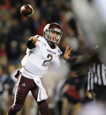 Texas A&M quarterback Johnny Manziel passes against Mississippi during an NCAA college football game Saturday, Oct. 6, 2012, in Oxford, Miss. (AP Photo/Oxford Eagle, Bruce Newman) MAGS OUT NO SALES  MANDATORY CREDIT Photo: Bruce Newman, Associated Press / Oxford Eagle