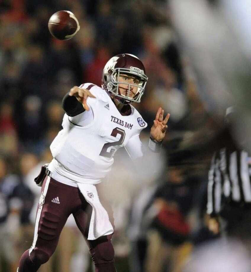Texas A&M quarterback Johnny Manziel passes against Mississippi during an NCAA college football game Saturday, Oct. 6, 2012, in Oxford, Miss.  Photo: Bruce Newman, Associated Press / Oxford Eagle