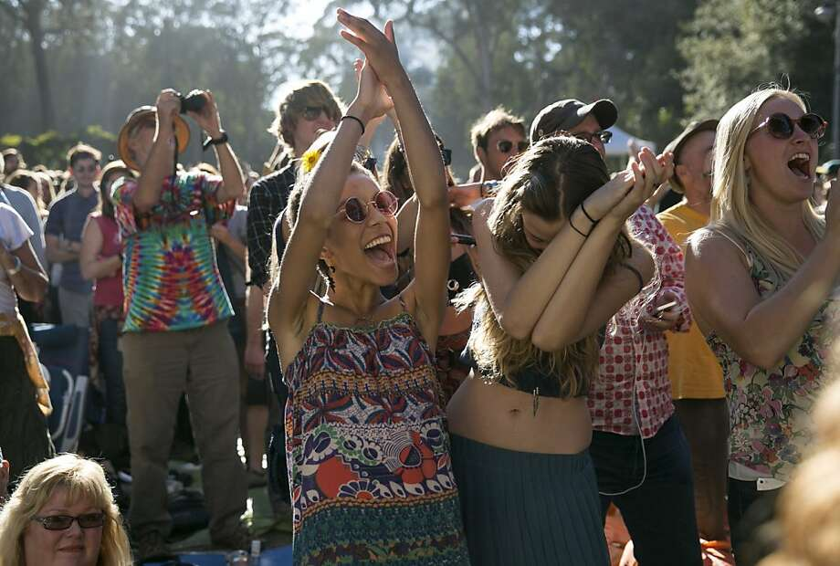 Christina Maycann (left) and Reilly Gallagher enjoy the music of Patty Griffin while watching her on the Rooster Stage at Hardly Strictly Bluegrass in Golden Gate Park in San Francisco, Calf., on Saturday, October 6, 2012. Photo: Laura Morton, Special To The Chronicle