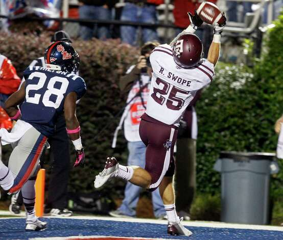 Texas A&M wide receiver Ryan Swope (25) reaches for a 20-yard touchdown reception against Mississippi  defensive back Mike Hilton (28) in the fourth quarter of an NCAA college football game in Oxford, Miss., Saturday, Oct. 6, 2012. Texas Af&M won 30-27. (AP Photo/Rogelio V. Solis) Photo: Rogelio V. Solis, Associated Press / AP
