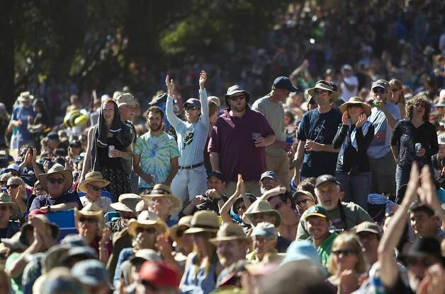 Fans pack Hellman Hollow in Golden Gate Park to watch a tribute to Warren Hellman, Earl Scruggs and Doc Watson on the Banjo Stage at Hardly Strictly Bluegrass in Golden Gate Park in San Francisco, Calf., on Saturday, October 6, 2012. Photo: Laura Morton, Special To The Chronicle