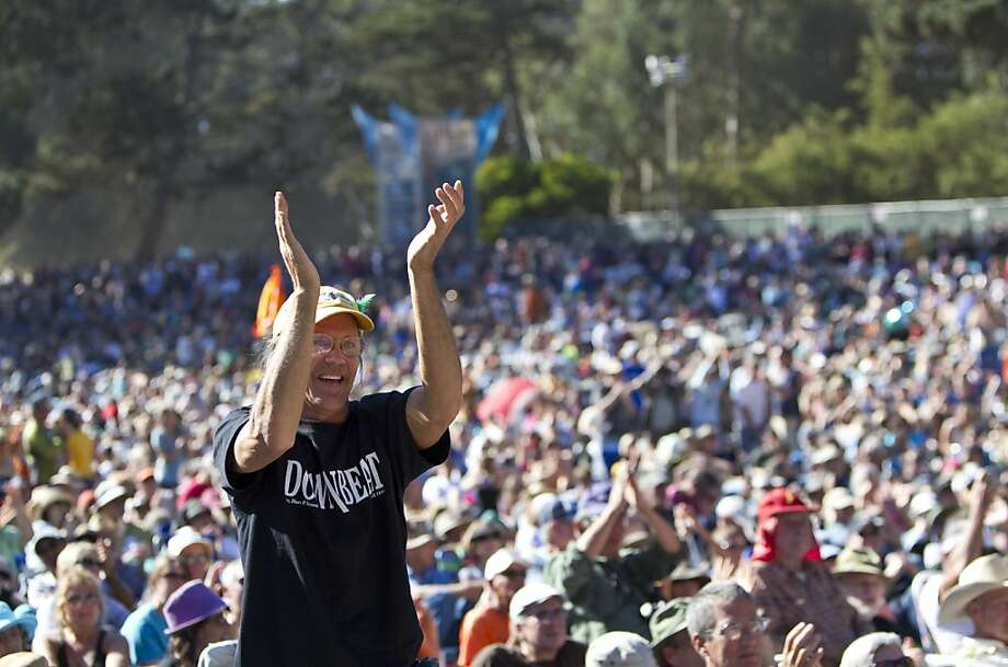 Randy Berge claps for the performers while watching a tribute to Warren Hellman, Earl Scruggs and Doc Watson on the Banjo Stage at Hardly Strictly Bluegrass in Golden Gate Park in San Francisco, Calf., on Saturday, October 6, 2012. Photo: Laura Morton, Special To The Chronicle