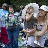 Kristina Baichl (right) holds her daughter Khloe Baichl while watching a performance at the Rooster Stage during Hardly Strictly Bluegrass at Golden Gate Park in San Francisco, Calf., on Saturday, October 6, 2012.