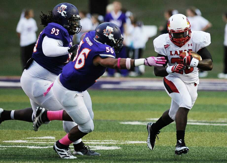 Lamar running back Herschel Sims charges down the field for another first down during Northwestern State football game against Lamar University at Northwestern State University on Saturday, October 6, 2012. Photo taken: Randy Edwards/The Enterprise