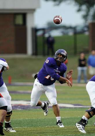 Northwestern State quarterback Brad Henderson, 10, completes a pass to wide receiver Sheldon McClain, 11,during Northwestern State football game against Lamar University at Northwestern State University on Saturday, October 6, 2012. Photo taken: Randy Edwards/The Enterprise