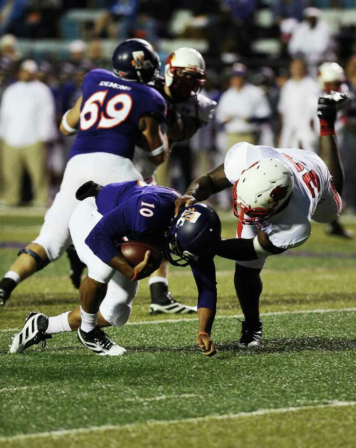 Lamar defensive end Joe Okafor sacks Northwestern State quarterback Brad Henderson on Saturday in Natchitoches, La. Lamar coach Ray Woodard said Okafor played his best game this season Saturday. Photo taken: Randy Edwards/The Enterprise