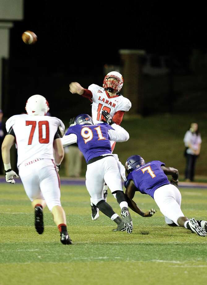 Lamar quarterback Caleb Berry, 12, is penalized for intentional grounding in the second quarter during Northwestern State football game against Lamar University at Northwestern State University on Saturday, October 6, 2012. Photo taken: Randy Edwards/The Enterprise
