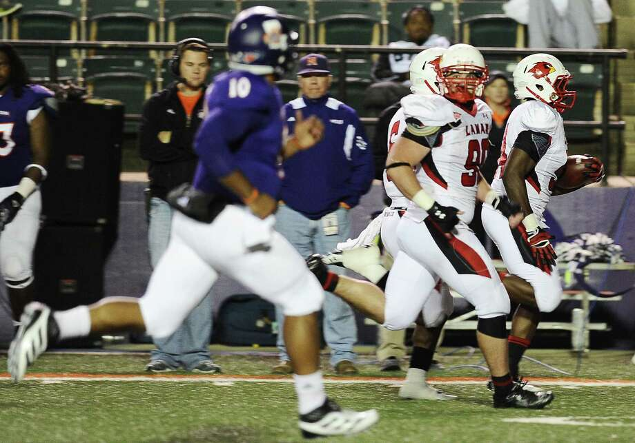 Lamar linebacker James Washington, 54, recovers a fumble and runs it back  62 yards for a touchdown during Northwestern State football game against Lamar University at Northwestern State University on Saturday, October 6, 2012. Photo taken: Randy Edwards/The Enterprise