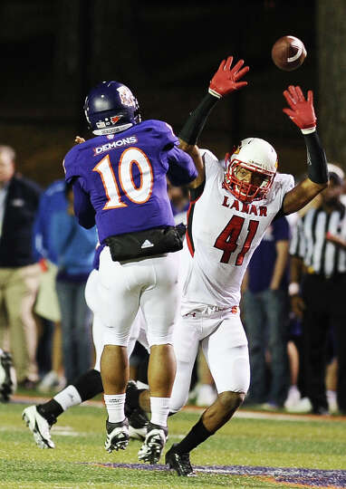 Lamar linebacker Jestin White attempts to block the pass with no luck during Northwestern State foot