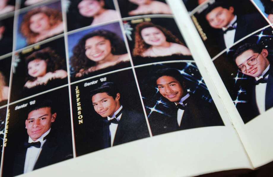 Twin brothers Julián and Joaquín Castro are shown in the 1992 yearbook of Thomas Jefferson High School during the 20th anniversary reunion at the Grand Hyatt on Saturday, Oct. 6, 2012. Although the brothers did not attend, their presence was felt. Photo: Billy Calzada, San Antonio Express-News / © San Antonio Express-News
