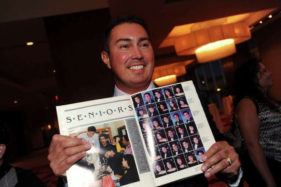 Jimmy Acosta, a classmate of twin brothers San Antonio Mayor Julián Castro and his brother, State Rep. Joaquín Castro, displays a yearbook during the Thomas Jefferson High School Class of 1992 Reunion at the Grand Hyatt on Saturday, Oct. 6, 2012. Photo: Billy Calzada, San Antonio Express-News / © San Antonio Express-News