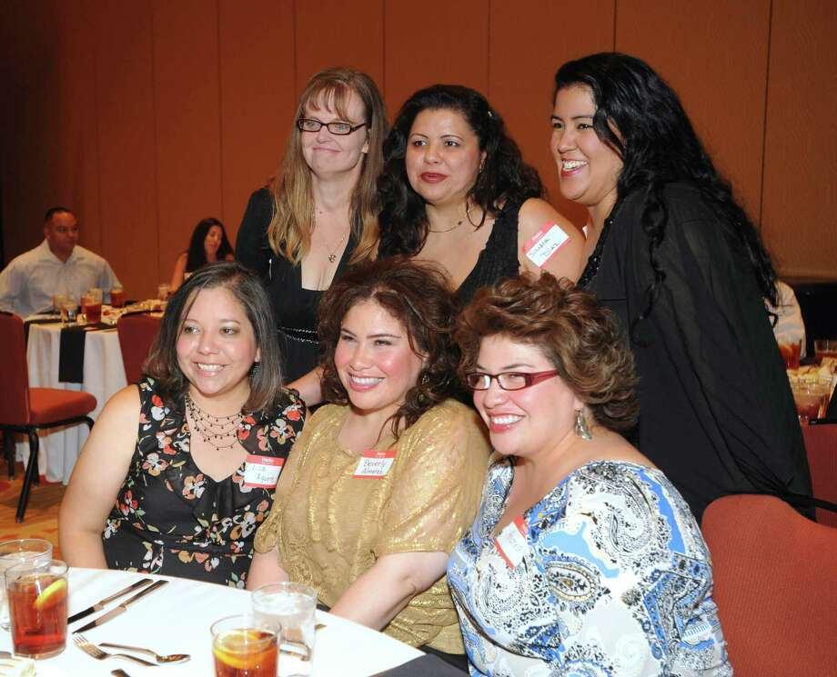 Front row from left: Elisa Aguirre, Beverly and Andrea Almaraz; back row from left: Faith Smith, Sandra Diaz and Carmen Perez attend the Thomas Jefferson High School Class of 1992 Reunion at the Grand Hyatt on Saturday, Oct. 6, 2012. San Antonio Mayor Julián Castro and his brother, State Rep. Joaquín Castro, were members of the class. Photo: Billy Calzada, San Antonio Express-News / © San Antonio Express-News