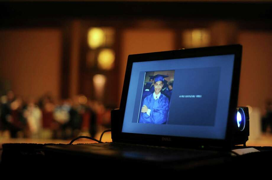 San Antonio Mayor Julián Castro, is displayed on a computer screen during a slideshow at the Thomas Jefferson High School Class of 1992 Reunion at the Grand Hyatt on Saturday, Oct. 6, 2012. Castro and his brother, Joaquín, who is running for a congressional seat, were members of the class. Although the brothers did not attend, their presence was felt. Photo: Billy Calzada, San Antonio Express-News / © San Antonio Express-News