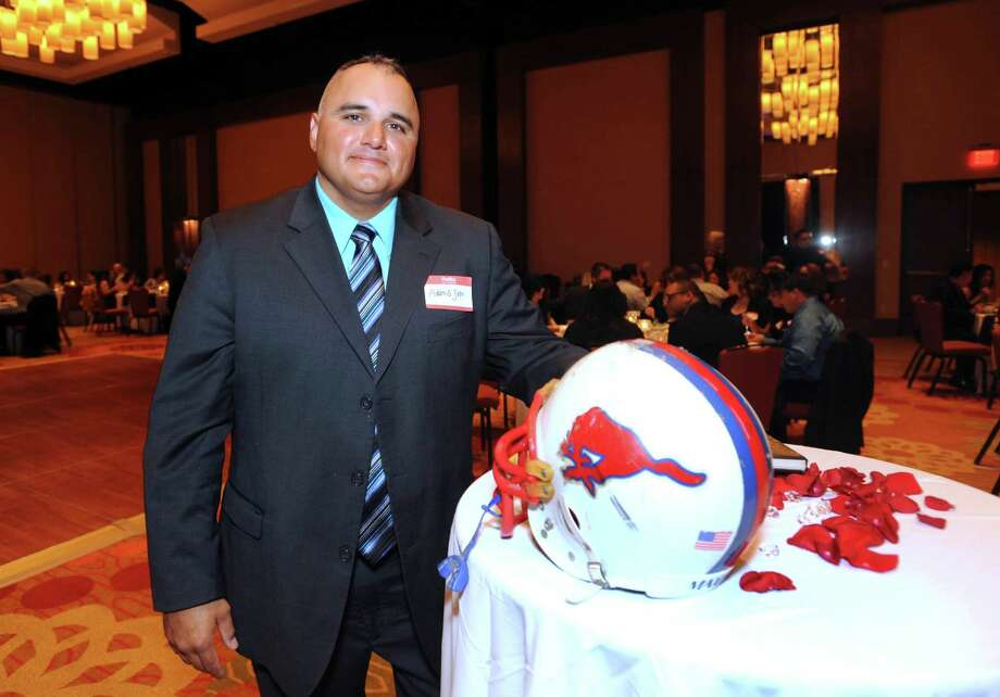 Adam Soto, who was a defensive end on the Thomas Jefferson High School football team, attends the 20th anniversary reunion of the class of 1992 at the Grand Hyatt on Saturday, Oct. 6, 2012. San Antonio Mayor Julián Castro and his brother, Joaquín, were members of the class. Photo: Billy Calzada, San Antonio Express-News / © San Antonio Express-News