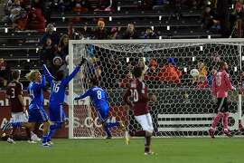 COMMERCE CITY, CO - OCTOBER 06:  Chris Wondolowski #8 of the San Jose Earthquakes celebrates his goal in the 11th minute against goalkeeper Matt Pickens #18 of the Colorado Rapids at Dick's Sporting Goods Park on October 6, 2012 in Commerce City, Colorado.  (Photo by Doug Pensinger/Getty Images)