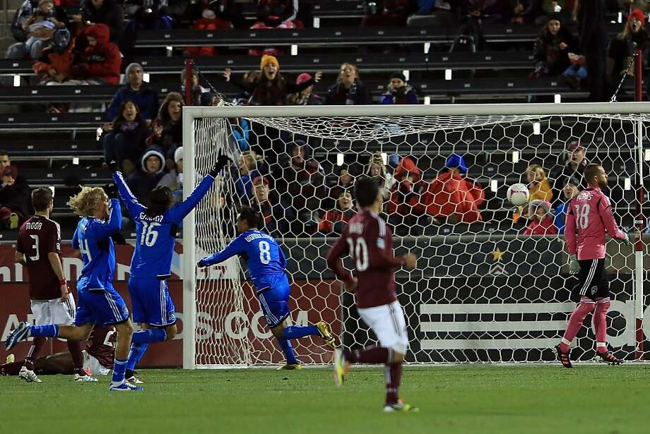 Chris Wondolowski (8) sends the ball into the net past Colorado goalkeeper Matt Pickens, scoring the first of his three goals to put the Earthquakes up 2-0. Photo: Doug Pensinger, Getty Images