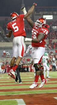 Houston running back Charles Sims, left, celebrates his touchdown run with offensive lineman Jacolby Ashworth during the second quarter of an NCAA college football game against North Texas, Saturday, Oct. 6, 2012, in Houston. (AP Photo/Houston Chronicle, Nick de la Torre) Photo: Nick De La Torre, Associated Press / Houston Chronicle