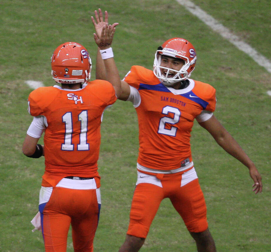 Sam Houston State's Brian Bell celebrates his touchdown on a fake field goal with Miguel Antonio during the second half. Photo: Eric Christian Smith, For The Chronicle