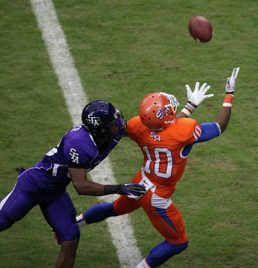 Sam Houston State's Torance Williams (10) hauls in a 30-yard touchdown reception past SFA's Jordan Aubrey during the second half of the Battle of the Piney Woods college football game, Saturday, October 6, 2012 at Reliant Stadium in Houston, TX. Photo: Eric Christian Smith, For The Chronicle