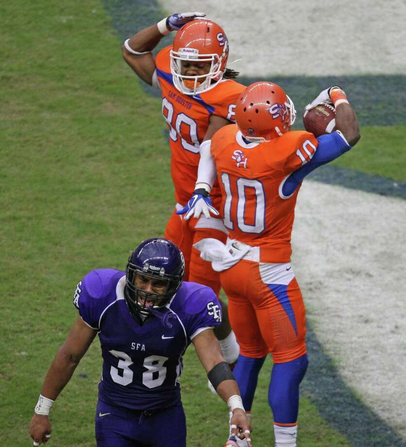 Sam Houston State's Torrance Williams (10) celebrates his 30-yard touchdown reception with Terrance Robinson as SFA's Jordan Aubrey argues with an official during the second half of the Battle of the Piney Woods college football game, Saturday, October 6, 2012 at Reliant Stadium in Houston, TX. Photo: Eric Christian Smith, For The Chronicle