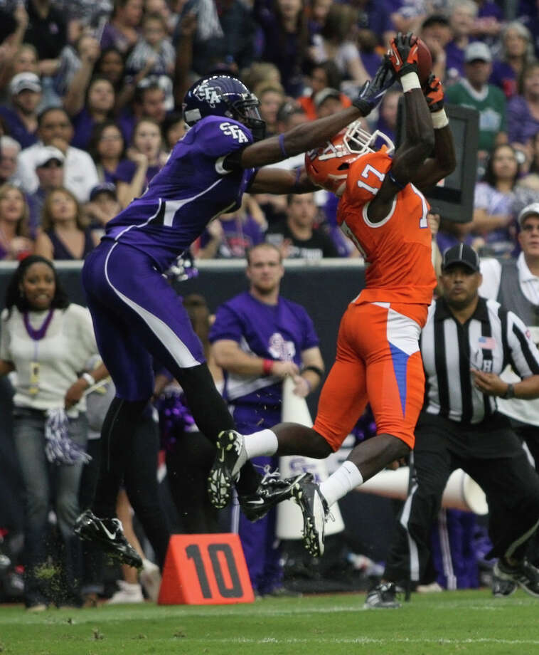 Sam Houston State's Bookie Sneed intercepts a pass intended for SFA's Marquis Mosley and returns it 92-yards for a touchdown. Photo: Eric Christian Smith, For The Chronicle