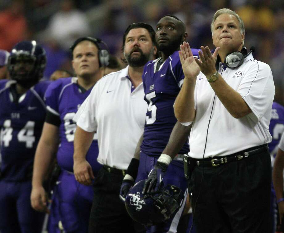 During the waning moments and with his team down by eight points, SFA head coach J.C. Harper (right) looks at the game clock during the second half of the Battle of the Piney Woods college football game, Saturday, October 6, 2012 at Reliant Stadium in Houston, TX. Photo: Eric Christian Smith, For The Chronicle