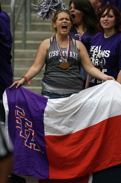 SFA 2010 alum Danielle Vanstrander cheers on the Lumberjacks  during the first half of the Battle of