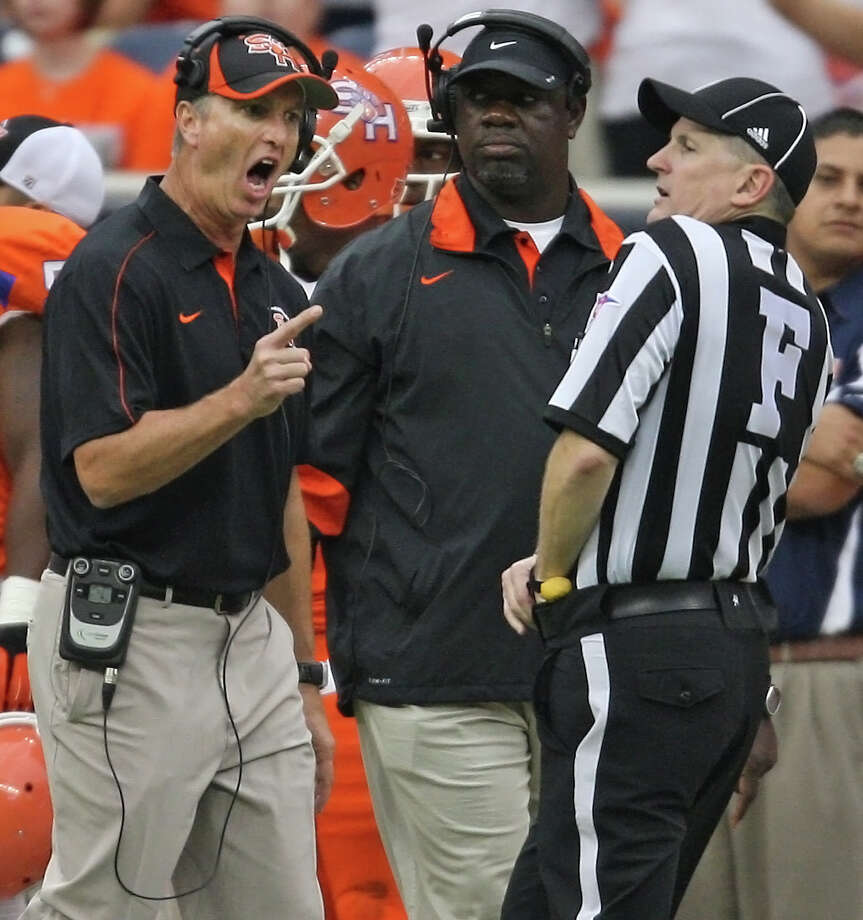 Sam Houston State head coach Willie Fritz (left) argues with an official during the first half of the Battle of the Piney Woods college football game against SFA, Saturday, October 6, 2012 at Reliant Stadium in Houston, TX. Photo: Eric Christian Smith, For The Chronicle