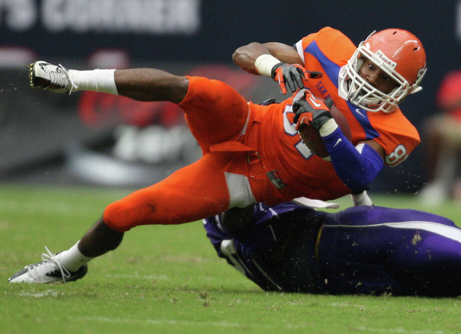 Sam Houston State's Chance Nelson (81) is tackled by SFA's Willie Jefferson during the first half of the Battle of the Piney Woods college football game, Saturday, October 6, 2012 at Reliant Stadium in Houston, TX. Photo: Eric Christian Smith, For The Chronicle
