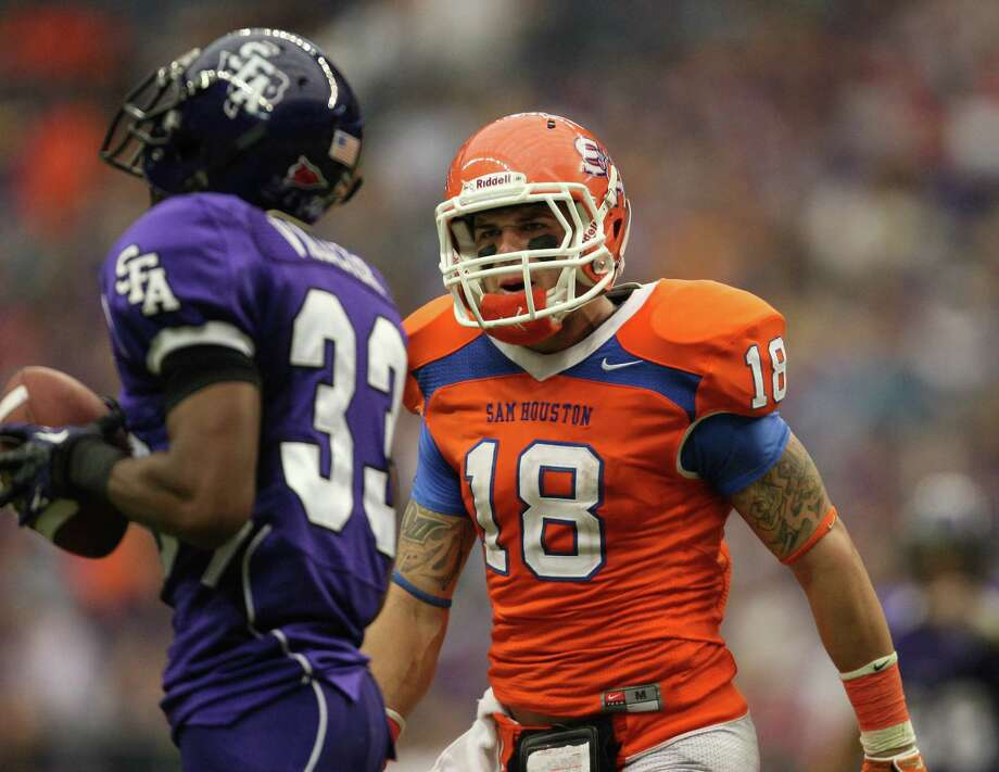 Sam Houston State's Trey Diller (18) yells at SFA's Trey Vallier after Vallier had a defensive holding penalty called on him during the first half of the Battle of the Piney Woods college football game, Saturday, October 6, 2012 at Reliant Stadium in Houston, TX. Photo: Eric Christian Smith, For The Chronicle