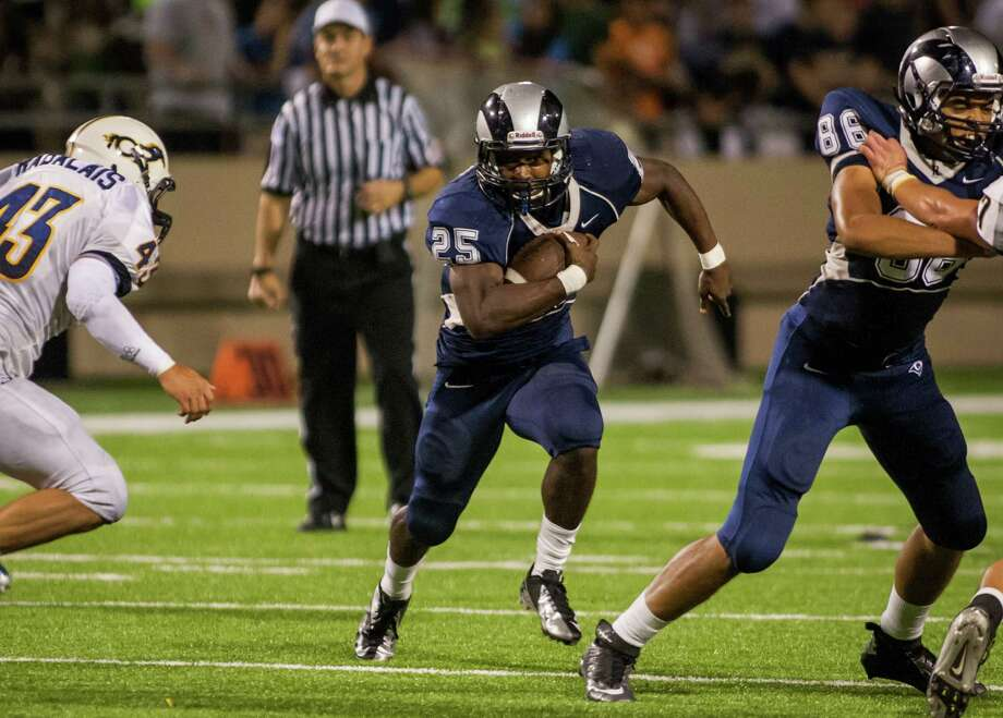 Cypress Ridge running back Rennie Childs (25) carries the ball during the third quarter of a high school football game at Pridgeon Stadium on Saturday, Oct. 6, 2012, in Houston.  Cypress Ranch defeated Cypress Ridge 35-28. Photo: Andrew Richardson, For The Chronicle / © 2012 Andrew Richardson