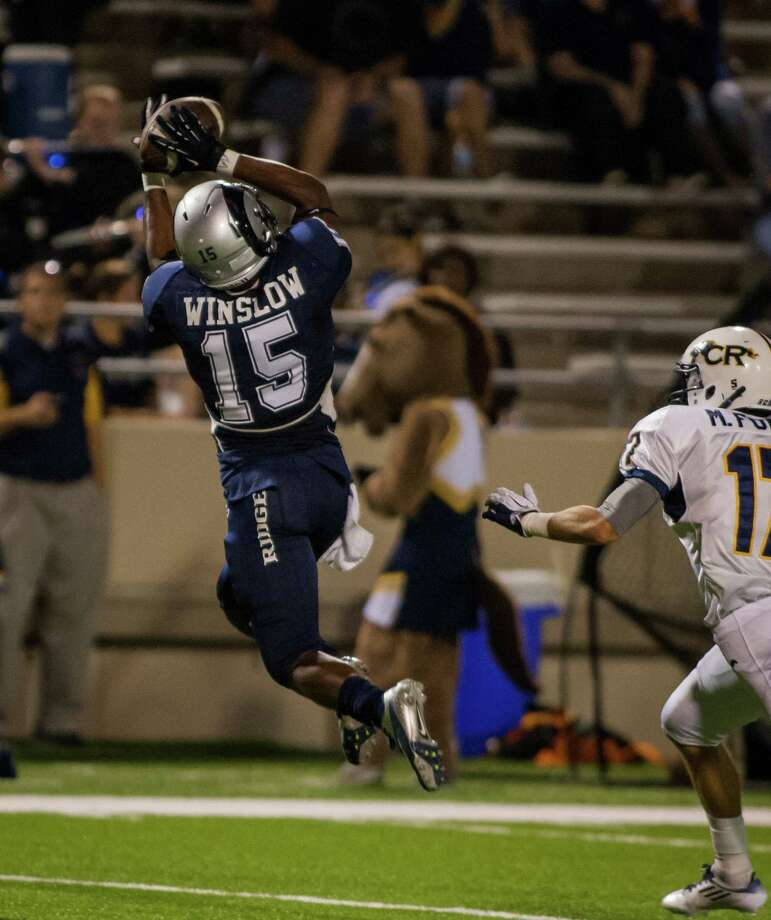 Cypress Ridge wide receiver Keldrick Winslow (15) makes a leaping catch during the fourth quarter of a high school football game at Pridgeon Stadium on Saturday, Oct. 6, 2012, in Houston.  Cypress Ranch defeated Cypress Ridge 35-28. Photo: Andrew Richardson, For The Chronicle / © 2012 Andrew Richardson