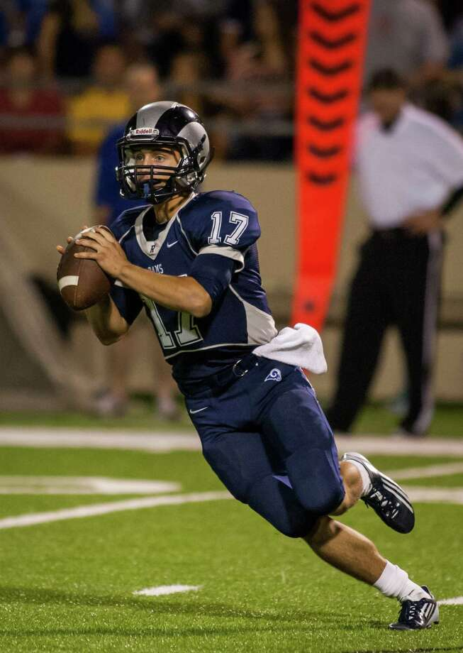 Cypress Ridge quarterback Garrett Pena looks for an open receiver during the fourth quarter of a high school football game at Pridgeon Stadium on Saturday, Oct. 6, 2012, in Houston.  Cypress Ranch defeated Cypress Ridge 35-28. Photo: Andrew Richardson, For The Chronicle / © 2012 Andrew Richardson