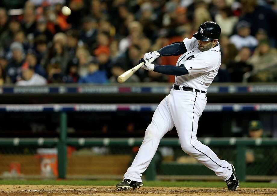 DETROIT, MI - OCTOBER 06:  Alex Avila #13 of the Detroit Tigers hits a solo home run in the bottom of the fifth inning against the Oakland Athletics during Game One of the American League Division Series at Comerica Park on October 6, 2012 in Detroit, Michigan.  (Photo by Leon Halip/Getty Images) Photo: Leon Halip