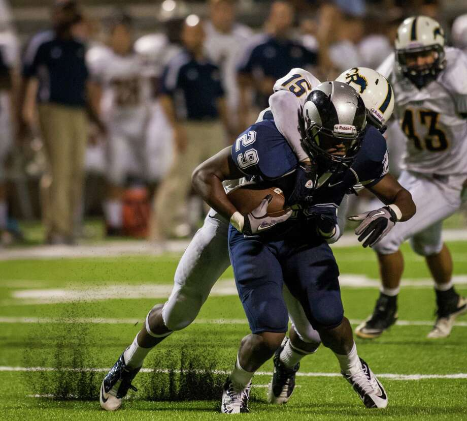 Cypress Ranch defensive back Randy Noel (15) brings down Cypress Ridge wide receiver John Patt (29) during the fourth quarter of a high school football game at Pridgeon Stadium on Saturday, Oct. 6, 2012, in Houston.  Cypress Ranch defeated Cypress Ridge 35-28. Photo: Andrew Richardson, For The Chronicle / © 2012 Andrew Richardson