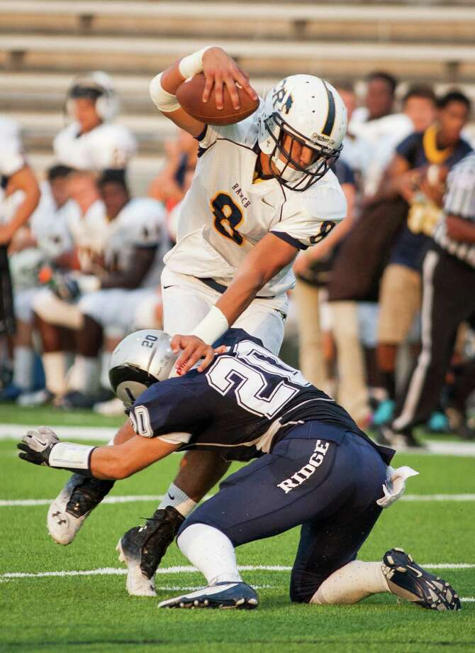 Cypress Ranch tight end Hunter Kliafas (8) avoids the tackle from Cypress Ridge defensive back Jacob Null (20) during the first quarter of a high school football game at Pridgeon Stadium on Saturday, Oct. 6, 2012, in Houston. Photo: Andrew Richardson, For The Chronicle / © 2012 Andrew Richardson