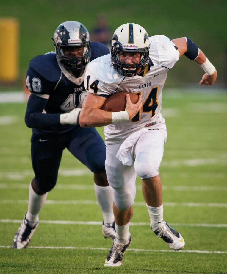 Cypress Ranch quarterback Cole Martin (14) takes off on a quarterback sneak to score a touchdown during the second quarter of a high school football game at Pridgeon Stadium on Saturday, Oct. 6, 2012, in Houston. Photo: Andrew Richardson, For The Chronicle / © 2012 Andrew Richardson