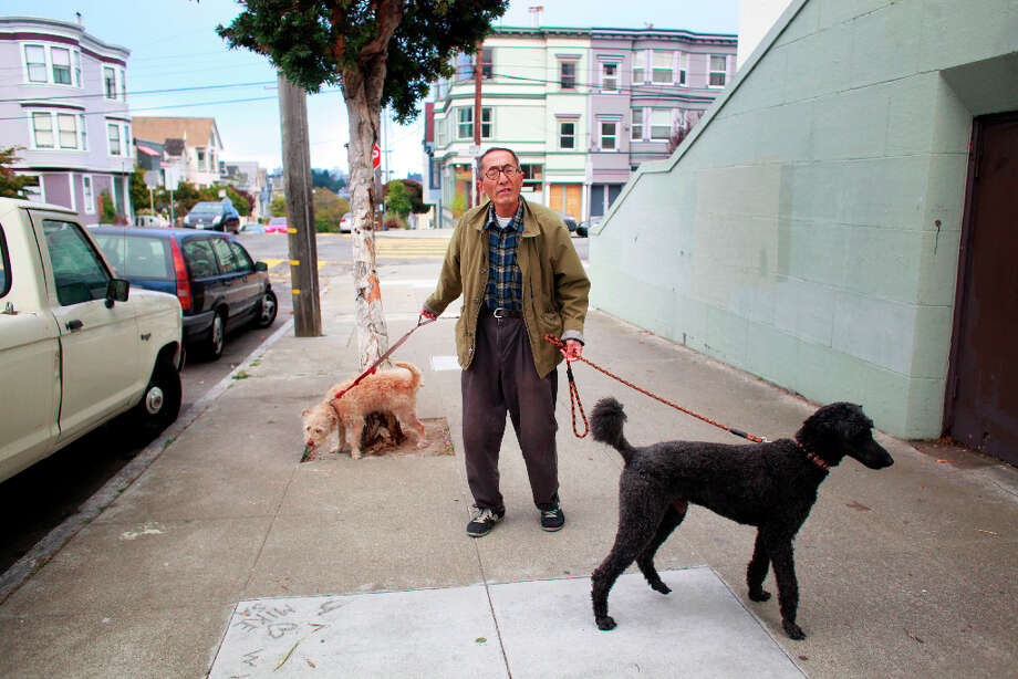 Before heading off to a gig at the Rite Spot Cafe, Toshio Hirano walks his dogs around the neighborhood. Photo: Mike Kepka, The Chronicle / ONLINE_YES