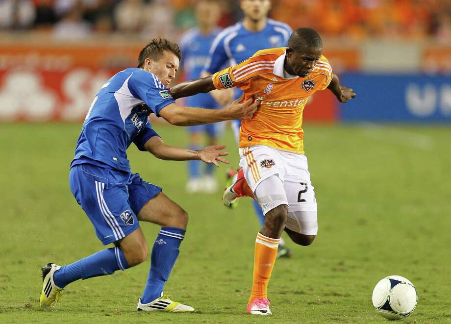 HOUSTON, TX - OCTOBER 06: Boniek Garcia #27 of the Houston Dynamo rushes the ball up the field as Jeb Brovsky #15 of the Montreal Impact pursues in the second half at BBVA Compass Stadium on October 6, 2012 in Houston, Texas. Montreal and Houston played to 1-1 tie. Photo: Bob Levey, Getty Images / 2012 Getty Images