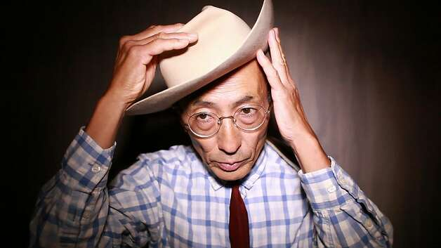 Toshio Hirano adjusts the Jimmie Rodgers inspired cowboy hat that he wears only when performing. Photo: Mike Kepka, The Chronicle