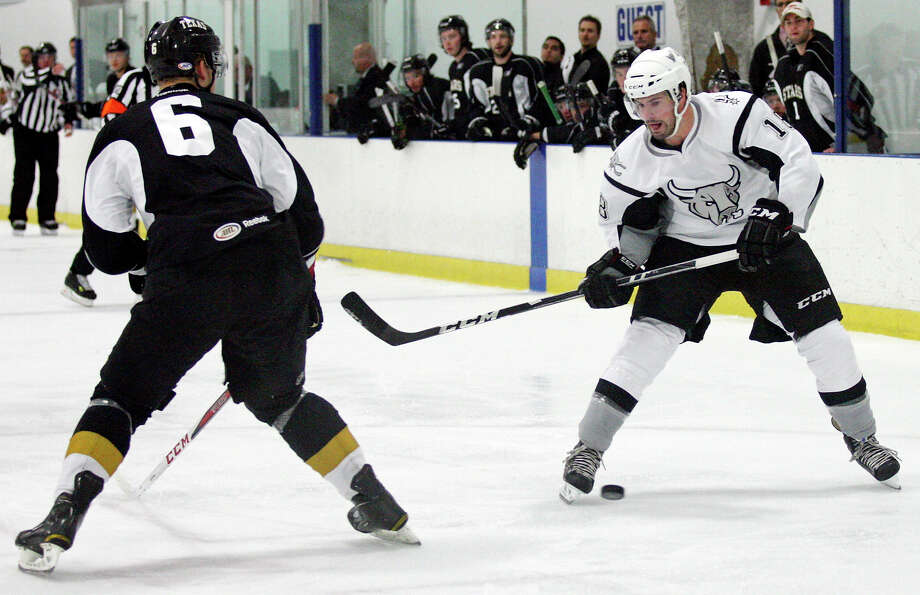 San Antonio Rampage's John McFarland looks for room around Texas Stars' Jamie Oleksiak  during first period action Saturday Oct. 6, 2012 at the Ice and Golf Center at Northwoods. Photo: Edward A. Ornelas, Express-News / © 2012 San Antonio Express-News
